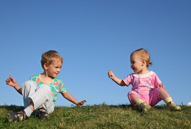 children-on-grass-with-flowers.jpg